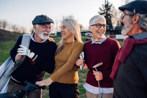 group of seniors golfing and laughing together