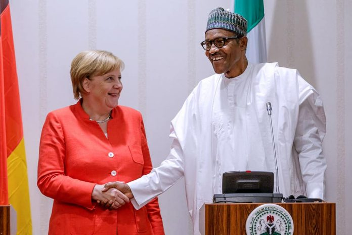 President Buhari in a handshake with German Chancellor Merkel at the State House Friday
