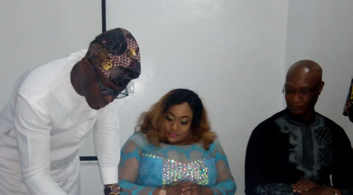L- r: Mr. Kayode Salako, with wife, Nollywood, Foluke Daramola-Salako, signing an agreement with Suru Group. Watching is CEO of Suru Group, Mr. Edward Akinlade during the unveiling of the actress as Suru Group new ambassador in Lagos … recently