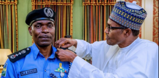 President Buhari decorating Acting Inspector General of Police Mohammed Adamu with his new rank in the State House, Abuja Tuesday