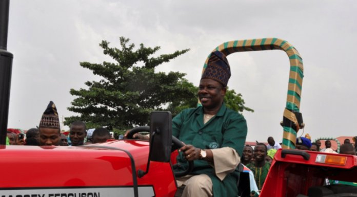 Ogun State Governor, Senator Ibikunle Amosun, driving a tractor during the launch of 86 units of land-clearing and land-preparation equipment in Abeokuta on Wednesday, February 13, 2013.