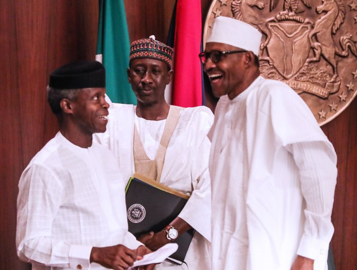 President Muhammadu Buhari and Vice President Yemi Osibanjo during a congratulatory visit by ministers and aides at the Council Chambers State, House Abuja on Friday