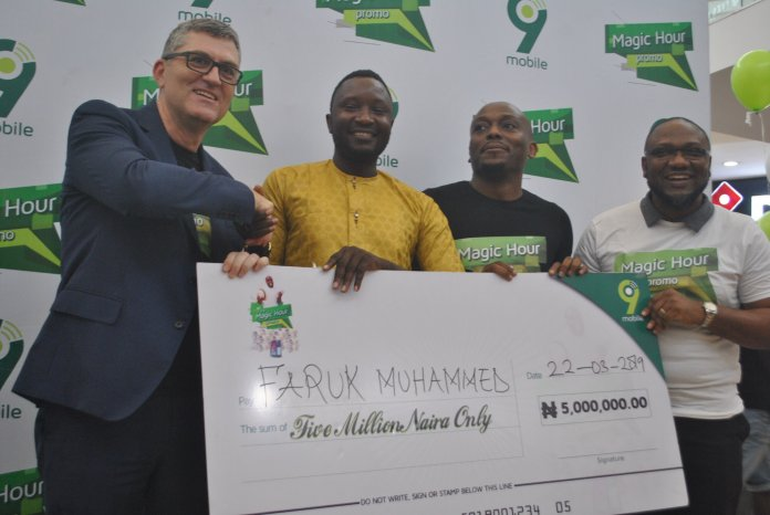 L-R: A.g Managing Director, 9mobile, Stephane Beuvelet; N5million prize winner of 9mobile Magic Hour Promo, Faruk Muhammed; Director, Regional Sale North, Tosin Olulana and Vice President, Marketing, Adebisi Idowu both of 9mobile, during the presentation to prize winners of the 9mobile Magic Hour Promo at the Jabi Lake Mall, Abuja