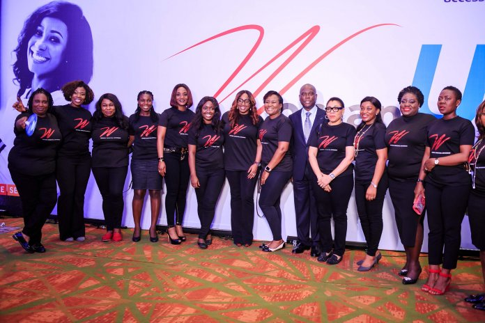 Herbert Wigwe (Centre) and members of Access Bank W community at The W Initiative International Women's Day conference 2019