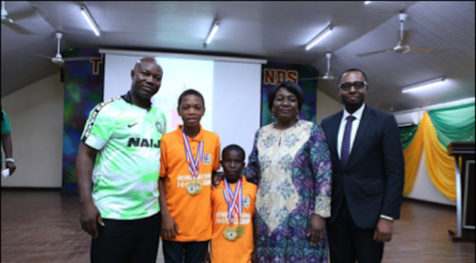 L-R: The Chairman Technical Committee, Lagos Football Association, Dotun Coker; Light Chijioke and Quadri Araromi, the two scholarship winners and the most promising players of 2019 Greensprings/Kanu Football Camp; the Executive Director, Greensprings School, Lagos, Lai Koiki; the Sector Lead, Education and Religious Institutions, Union Bank, Emmanuel Essien, at the closing ceremony of the Greensprings/Kanu Football Camp, in Lagos... recently