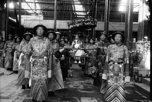 The Empress Dowager Cixi in sedan chair surrounded by eunuchs, China, Qing dynasty, 1903-1904 ...
