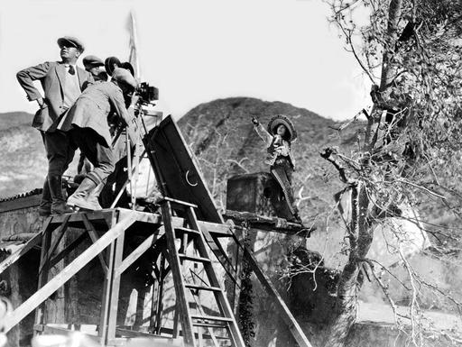 Mae Murray points something to her husband, director Robert Z. Leonard on the set of ...