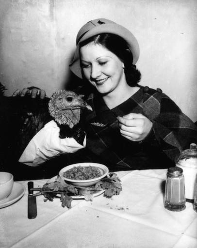 Girl feeds bib wearing turkey at a restaurant in Los Angeles, CA - c. 1930sThis is me at ...