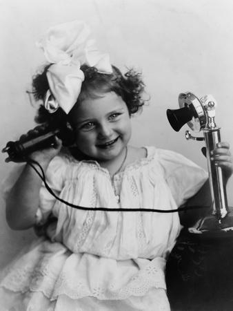 Little Girl Talking on an Early Model Telephone, Ca. 1905 Photo at AllPosters