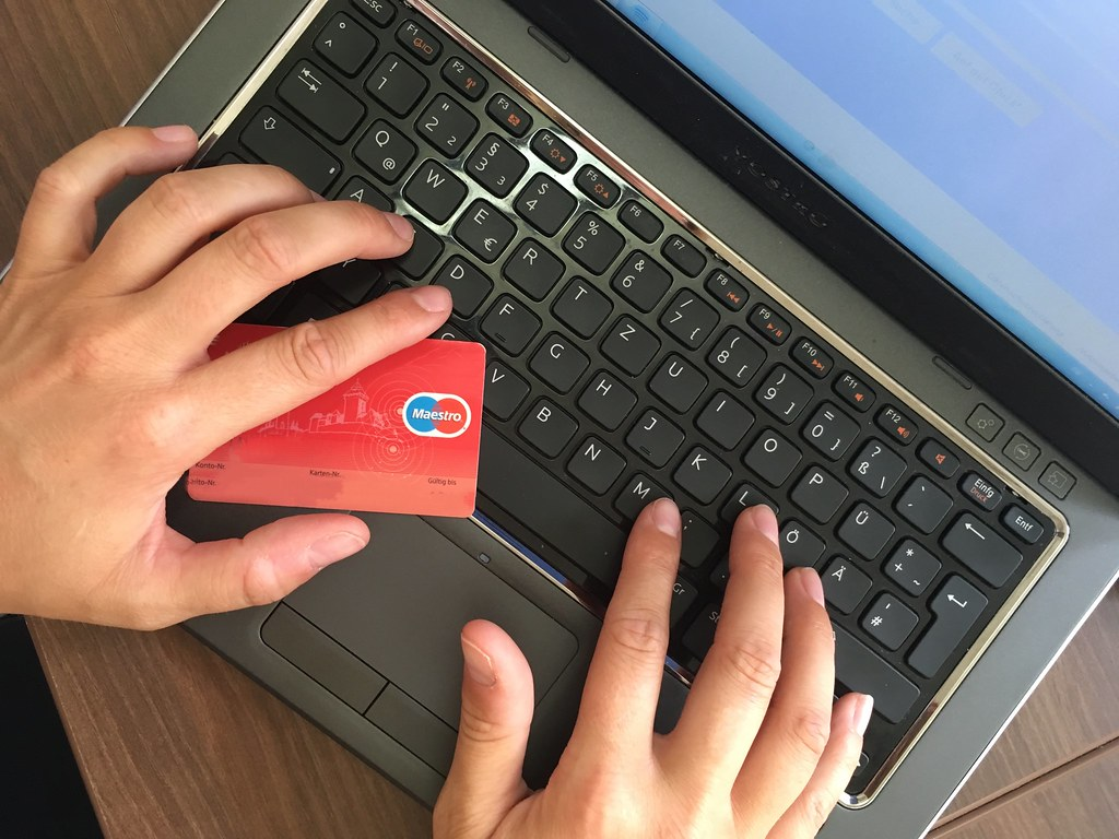 person-at-laptop-with-credit-card-buying-cheap-insurance