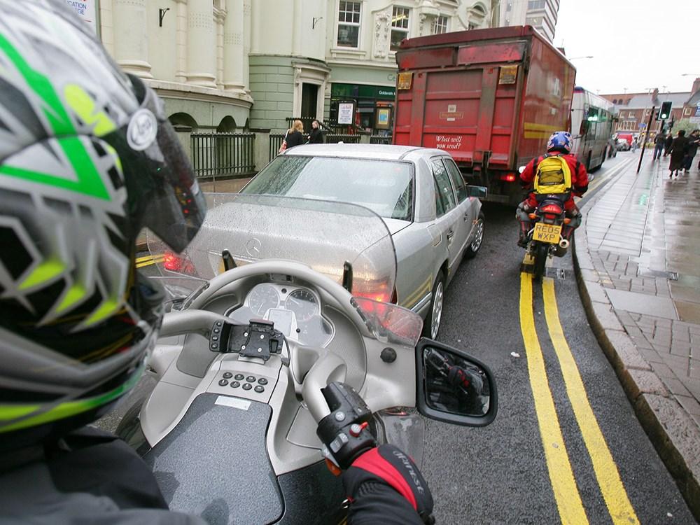 motorbike-rider-sat-in-traffic