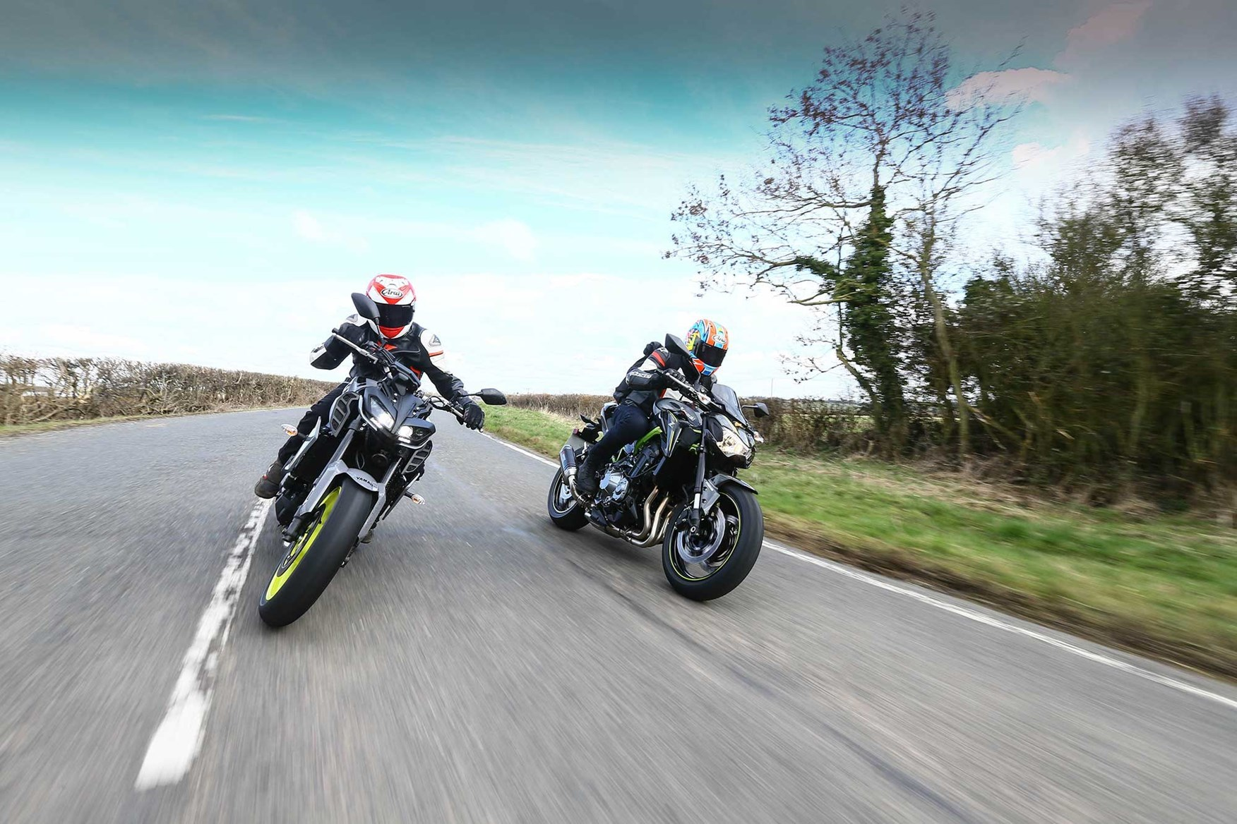 two-motorbikes-riding-on-road