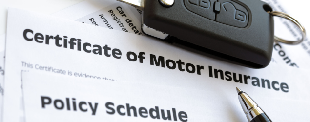 motor insurance certificate under a car key