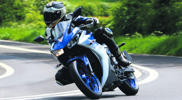 man_riding_yamaha_yzfr3