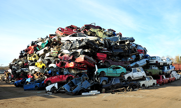 A pile of wreaked vehicles in the scrap yard