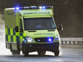 ambulance on the road in UK thumb