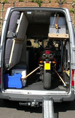 motrbike loaded in the back of a van using a ramp