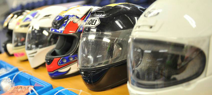 helmets laid out at Biker Down rider safety course