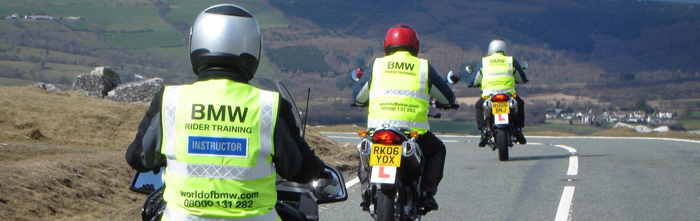 learner riders on the road with instructors