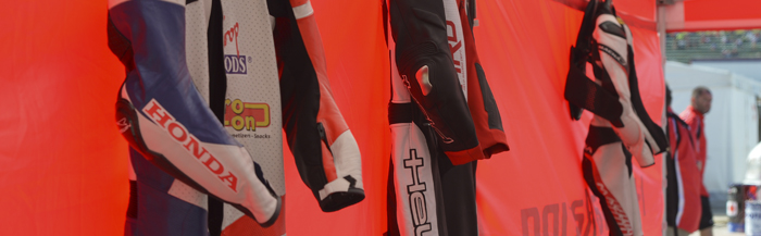 leathers hanging up at EJC race at Imola 700px