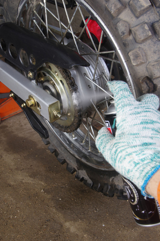 lubricant applied to motorbike chain