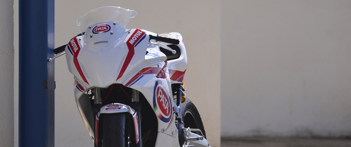 motorbike leaning against a garage wall at the EJC training camp in Calafat 2015 700px