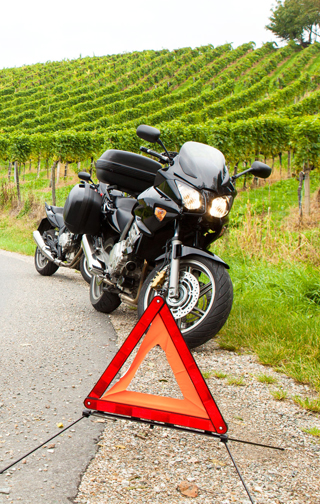 motorcycle broken down at the side of the road in Europe