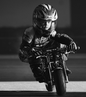 young rider on mini moto at indoor track