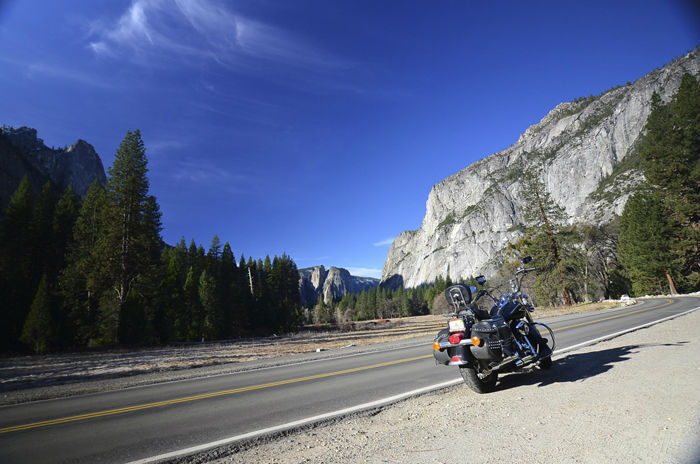 Harley Davidson in the shadows of a monolith in Yosemite National Park