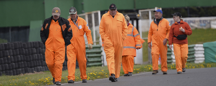 marshals strolling down the track enroute to their positions 700px slim