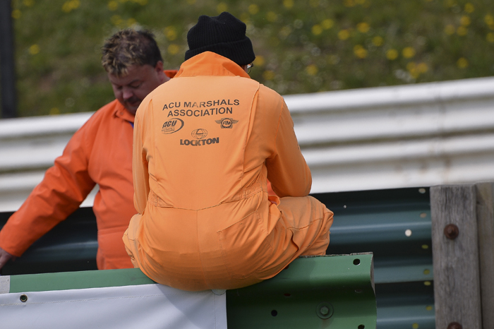 marshals waiting between races