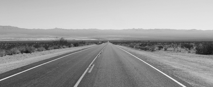 deserted road and landscape image 700px slim