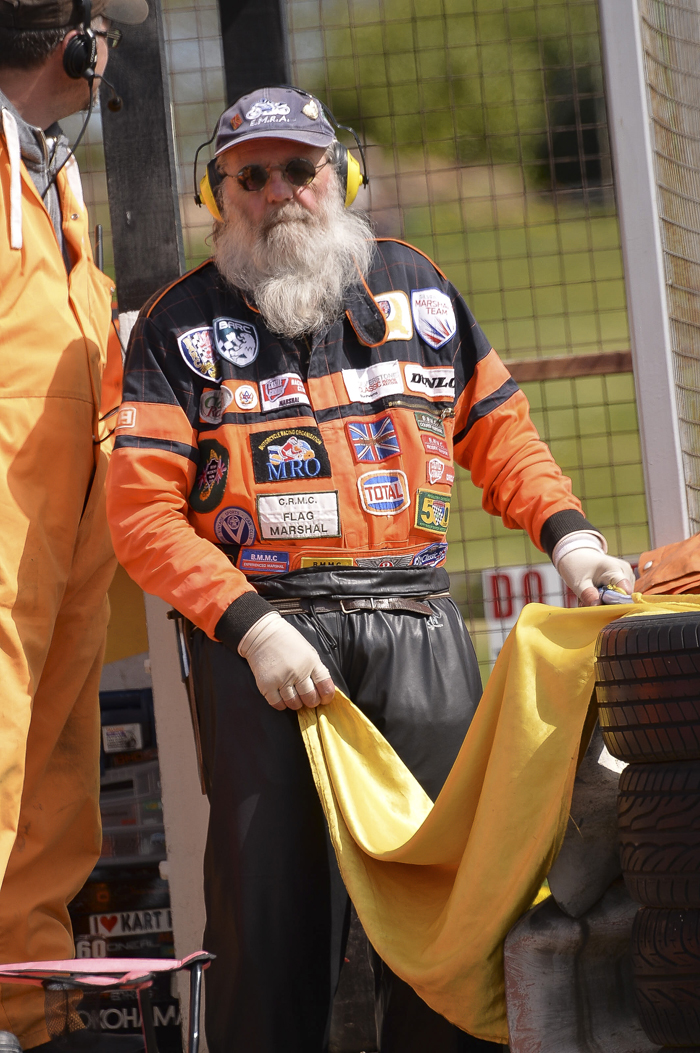 Marshal holding the yellow flag on the sidelines