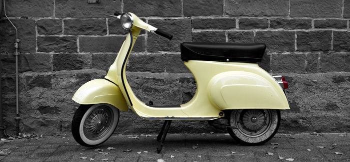 Vespa parked up in an Italian side street (content image)