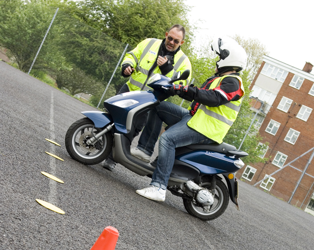 Learner rider taking Module 1 of their motorcycle test on a moped
