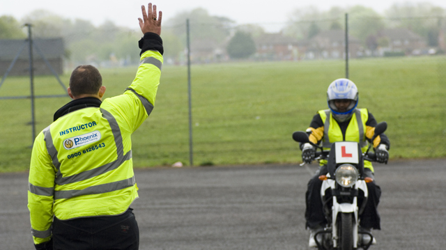 Learner rider under instruction during their test