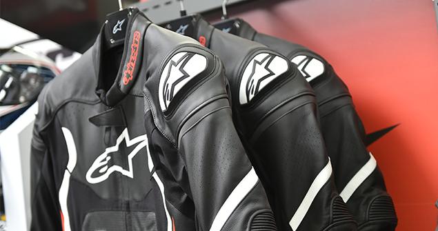 Designer black motorcycle jackets hanging up on coat hanger