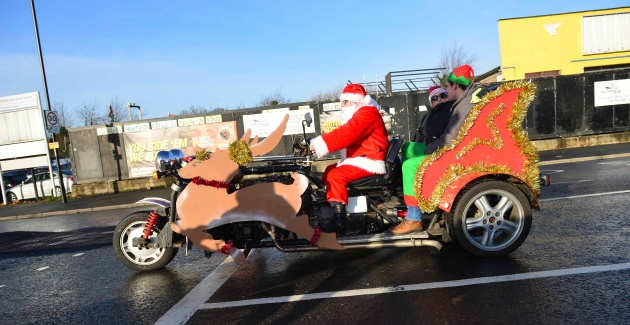 Santa on motorcycle decorated like sleigh