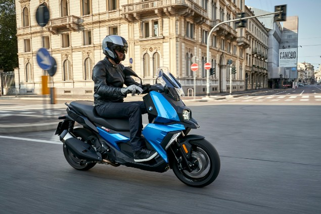 man-riding-a-BMW-c400x-on-road