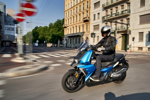 man-riding-new-bmw-2400x-2018-on-the-street-corner
