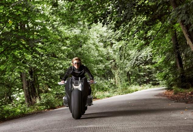 person-riding-bmw-motorrad-through-a-forrest