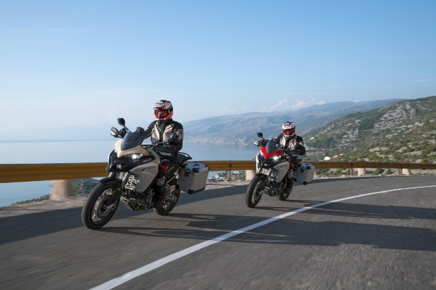 two-ducati-multistrada-1260-enduro-motorcycles-in-action-with-sea-background