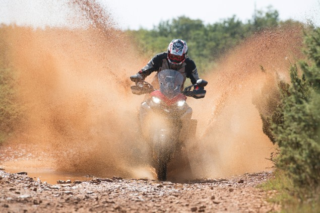 motorcyclist-riding-multistrada-1260-enduro-through-mud