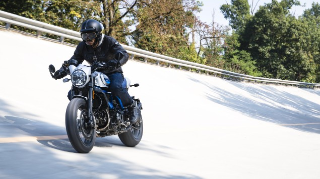Blue-and-white-Ducati-Scrambler-Cafe-Racer-in-action