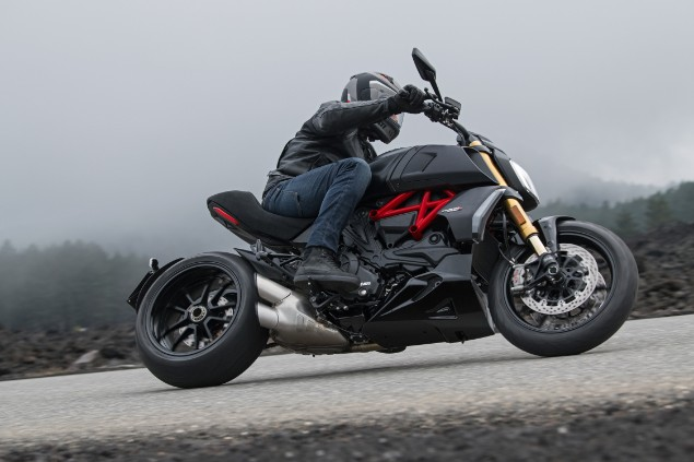 Person riding Ducati Diavel S motorcycle on road