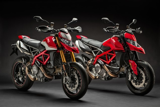 Two red Ducati Hypermotard 950 motorbikes stationary