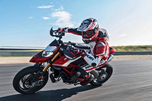Motorcyclist riding Ducati Hypermotard 950 on race track