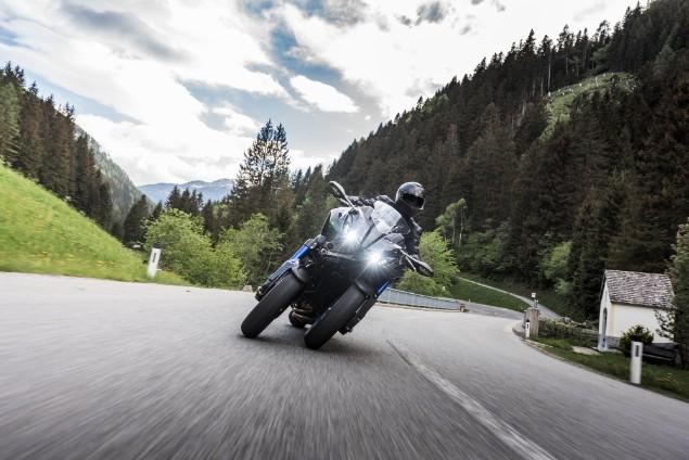 Yamaha Niken GT motorcycle riding in countryside