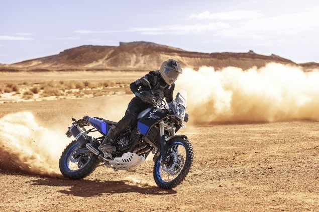 motorcyclist riding blue 2019 Yamaha Tenere 700 in desert