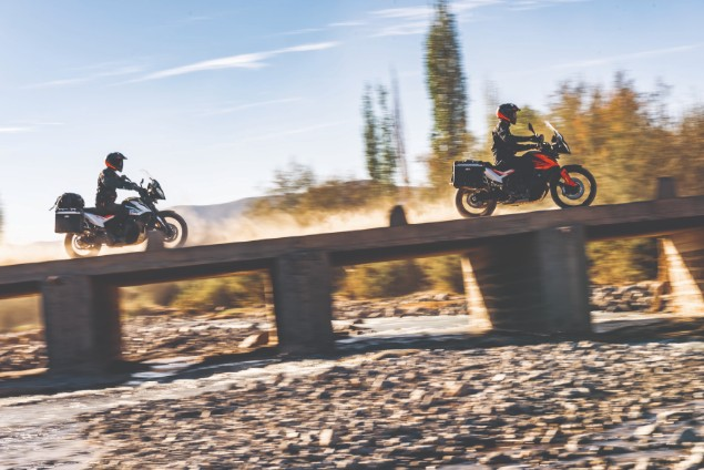 Two KTM 790 Adventure motorcycles riding on bridge